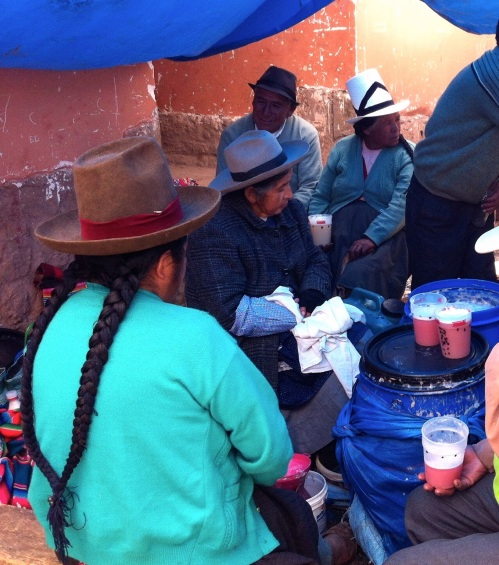 Chinchero market, locals resting, drinking their pink corn juice