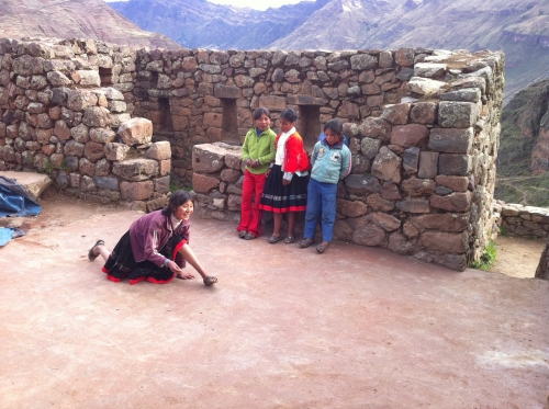 cute Quechua girls are playing in the ruins