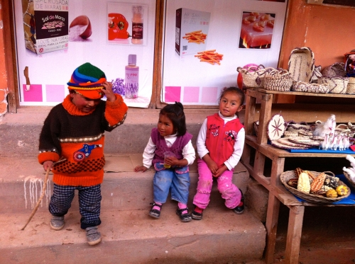 kids near a stand selling salt from the Salinas