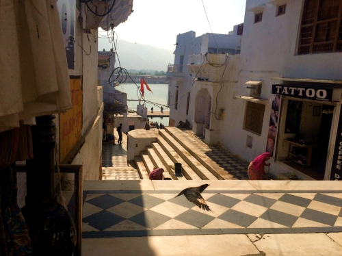 Ghats, stone steps descending to the lake edge, used for sacred bathing and ceremonies