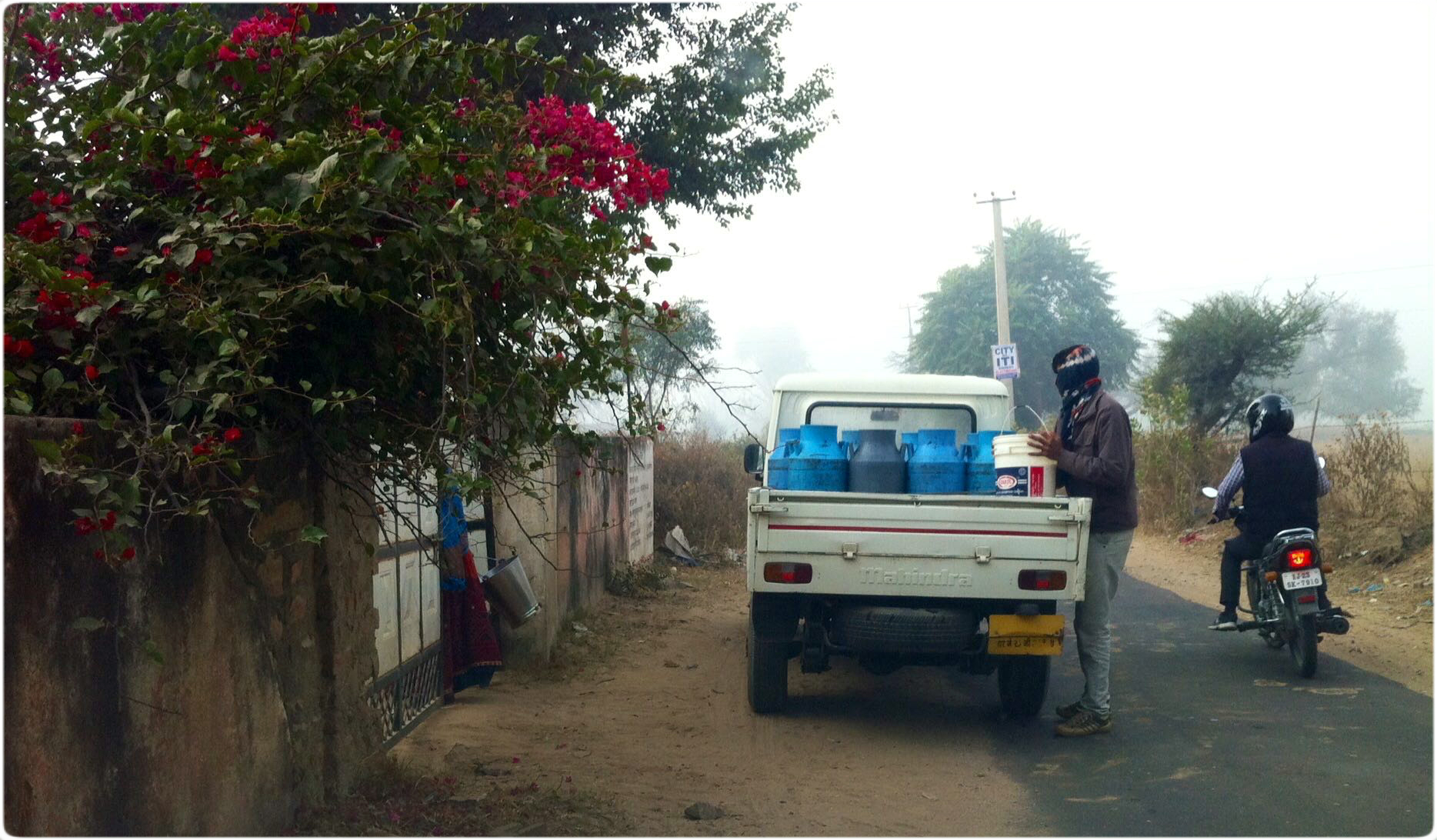 Ok, one last one- notice the woman to the left waiting for the milkman, to fill her bucket with milk